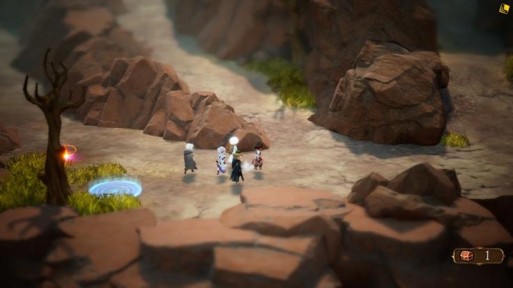 Five people walking along cliffs.